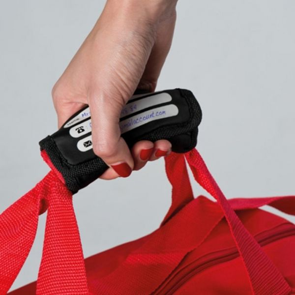Carrying strap for bags with address field